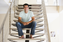 Royalty Free Photo of a Man on a Staircase