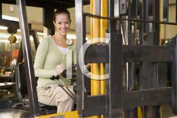 Royalty Free Photo of a Warehouse Worker in a Forklift