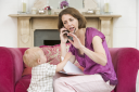 Royalty Free Photo of a Mother Talking on the Phone