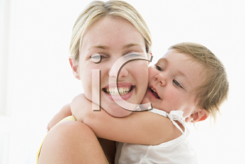 Royalty Free Photo of a Mother and Baby Hugging