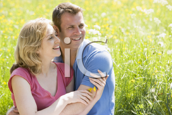 Royalty Free Photo of a Couple in a Meadow