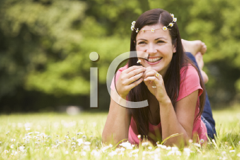 Royalty Free Photo of a Woman Lying in the Grass