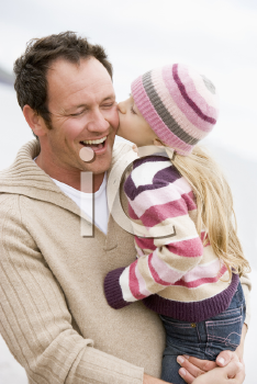 Royalty Free Photo of a Father Kissing His Daughter