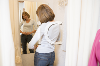 Royalty Free Photo of a Woman Trying on Jeans