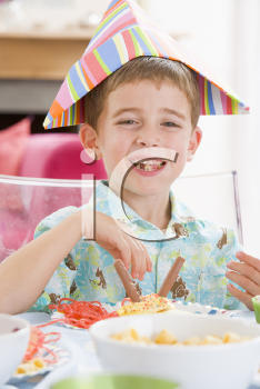 Royalty Free Photo of a Little Boy at a Birthday Party
