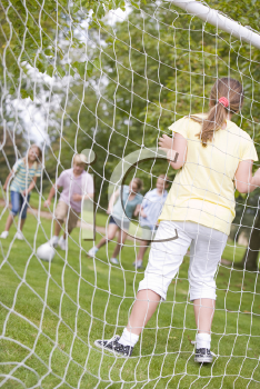 Royalty Free Photo of a Friends Playing Soccer