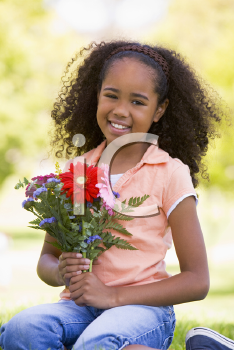Royalty Free Photo of a Young Girl With Flowers