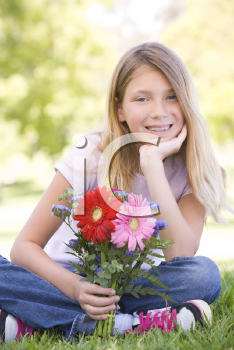 Royalty Free Photo of a Girl Holding Flowers
