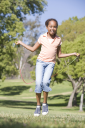 Royalty Free Photo of a Girl Skipping