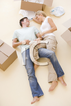 Royalty Free Photo of a Couple Lying on the Floor