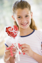 Royalty Free Photo of a Girl With a Valentine Balloon