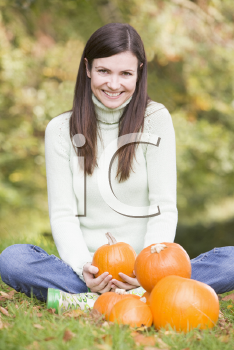 Royalty Free Photo of a Woman With Pumpkins