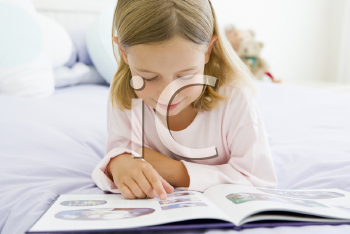 Royalty Free Photo of a Young Girl Reading a Book