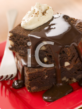 Royalty Free Photo of Brownies With Fudge Sauce and Whipped Cream