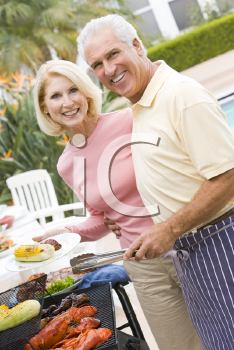 Royalty Free Photo of a Couple Barbecuing
