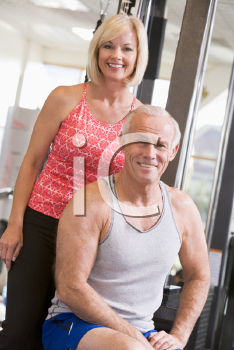 Royalty Free Photo of a Man and Woman at a Gym