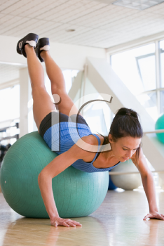 Royalty Free Photo of a Woman Working Out on a Medicine Ball