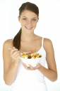 Royalty Free Photo of a Teen Eating Fruit Salad