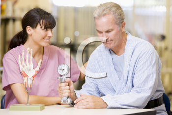 Royalty Free Photo of a Nurse Working With a Patient