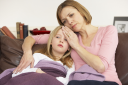 Royalty Free Photo of a Mother With Her Sick Daughter