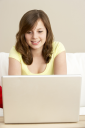 Royalty Free Photo of a Girl at Home With a Laptop