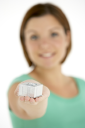 Royalty Free Photo of a Woman Holding a Small Gift