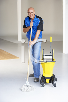 Royalty Free Photo of a Man Mopping a Floor