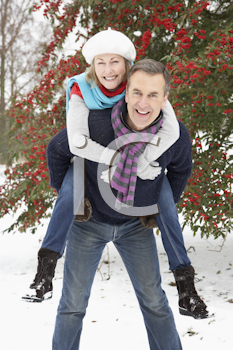 Royalty Free Photo of a Couple Having Fun in the Snow