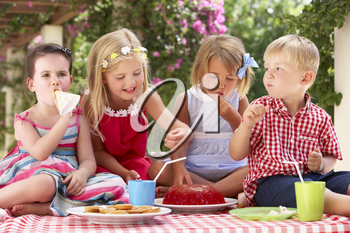 Group Of Children Eating Jelly At Outdoor Tea Party