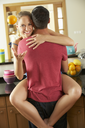 Romantic Couple Hugging In Kitchen