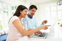 Indian Couple Making Online Purchase At Home