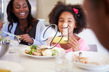 Mother And Daughter Having Family Meal At Table