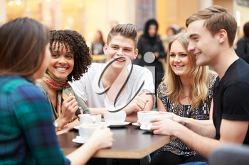 Group Of Young Friends Meeting In Caf�