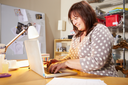 Mature Woman Checking Orders For Home Business On Laptop