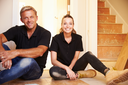 Man and woman sitting on floor during house refurbishment