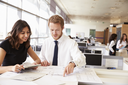 Young man and woman working together in architect?s office