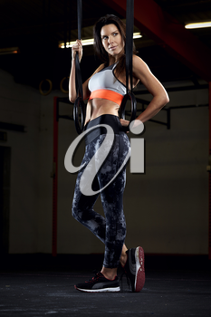 Woman In Gym With Olympic Rings
