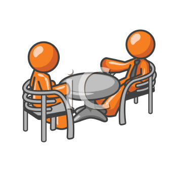 Two orange men at a table consulting over matters.