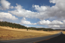 Road to the Grand Canyon. Autumn yellow fields and the magnificent cloudy sky