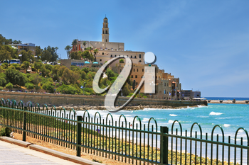 Ancient and modern port of Jaffa in Israel. The seafront fenced openwork low fence