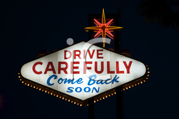 Royalty Free Photo of the Drive Carefully Sign in Las Vegas at Night