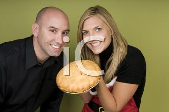 Royalty Free Photo of a Woman Holding a Pie