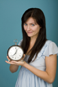 Royalty Free Photo of a Woman Holding a Clock
