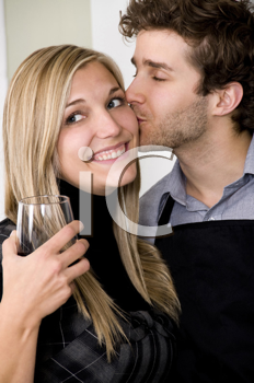 Royalty Free Photo of a Guy Kissing a Girl on the Cheek