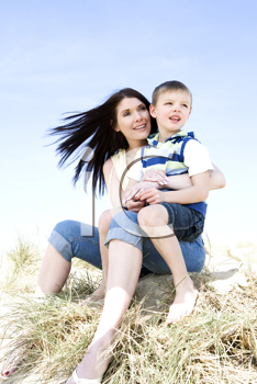 Royalty Free Photo of a Mother and Son at the Beach