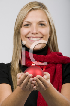 Royalty Free Photo of a Woman Holding an Ornament in the Palms of Her Hands
