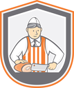 Illustration of a butcher cutter worker holding butcher knife chopping ham set inside shield crest shape on isolated background done in cartoon style.