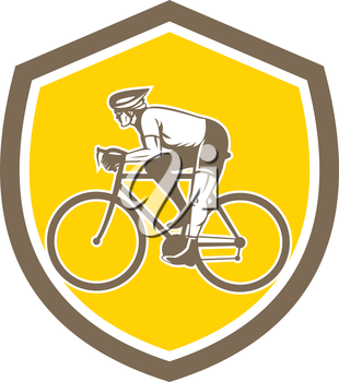 Illustration of a cyclist biking riding mountain bike viewed from the side set inside shield crest on isolated background done in retro style.