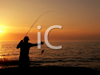 Royalty Free Photo of an Angler at Dusk