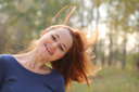 Young redhead woman in the park having fun